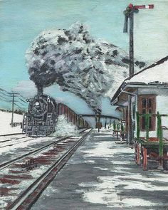 The freight train passes the station on a very cold, winter day.