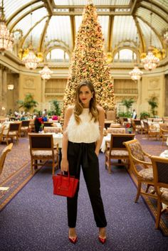 25 new years eve outfit ideas - white feather top, black trousers +  festive red heels and tote bag