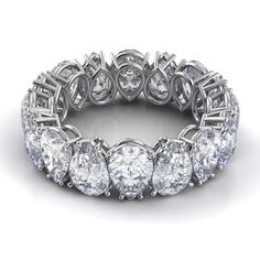 Alternating and inverted diamond pear-cut eternity band . . . v.interesting.