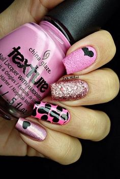 Beautiful pink and black heart design Nail Art design