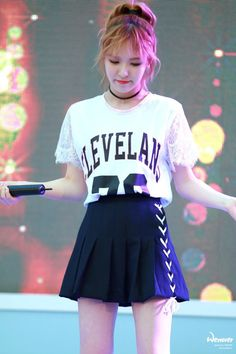 sports tee + black pleated A-line skirt (Wendy, Red Velvet)