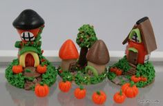 Tiny fall village made out of polymer clay.
