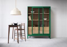 The Joyce cabinet has sliding glass-fronted doors and a timber-lined interior with four adjustable shelves and four drawers. There are 2 cable grommets above the drawers.