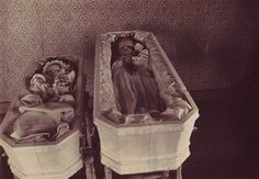 A real photo postcard showing two sisters laid out in matching coffins. An inked inscription verso in a fine period hand identifies the girls as Claudia Severine Groth / Born Sept. 30, 1908 / Died Feb. 20, 1911 and Millie Cecelia / Born Dec. 25, 1910 / Died Feb. 21, 1911. Underneath this the inscription identifies their mother, Mrs E. O. Groth / Enderlin / N. Dak.
