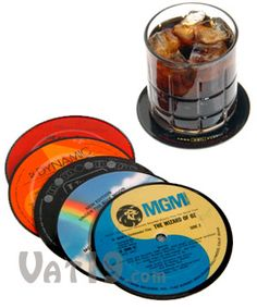 Recycled LP Record Coasters $19.99  What to do with all those old outdated LP vinyl records that aren't needed anymore? Well, instead of filling up our landfills, some entrepreneurial and environmental minded genius came up with the idea to recycle them into drink coasters! Brilliant! Recycled LP Record Coasters feature various and random artists from all music eras. Cool gift idea for retro and music lovers!