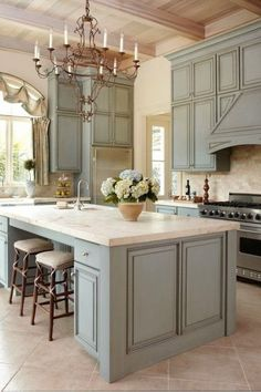 Ok, I found my dream Kitchen.. I LOVE the gray cabinets, the wood ceiling, the wall color... to me this is perfection