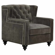 A handsome addition to your living room or parlor, this velvet-upholstered arm chair showcases a button-tufted back and nailhead trim.
