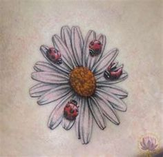 http://deborahfantasia.hubpages.com/hub/Daisy-Flower-Tattoos  I was thinking of something like this but with bumble bees to represent my boys