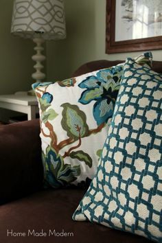 turquoise pillows on brown couch