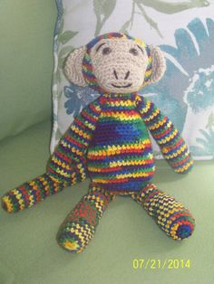 Rainbow colored stuffed monkey-hand by MadeinMassachusetts on Etsy