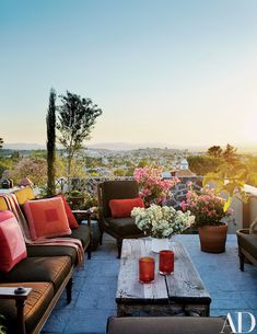 The roof terrace of the guest casita provides stunning views of the town and its surroundings; the teak sofa and chairs are by Michael Taylor Designs, with cushions covered in a Sunbrella fabric.