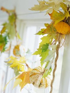 beautiful - knot clusters of fresh leaves & mini pumpkins onto twine & swag across top of window