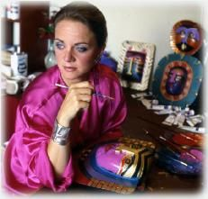 Laurel Burch (12/31/45-9/13/07) at work.  Still love her whimsical, colorful pieces.  They make me smile.  Earrings, sock and tote deposits forever accepted.  :)