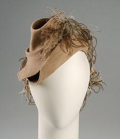 Hat  Sally Victor  (American, 1905–1977)    Date:      1942  Culture:      American  Medium:      Fur, wool, feathers  Credit Line:      Brooklyn Museum Costume Collection at The Metropolitan Museum of Art, Gift of the Brooklyn Museum, 2009; Gift of Sally Victor, Inc., 1944