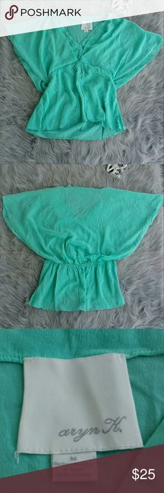 """ARYN K Anthropologie Mint Silk Angel Sleeve Blouse Great  pre-owned condition silk blouse with angel sleeves. Mint green color is gorgeous. 100% silk. Length: 25"""". Bust (laid flat):12"""".  Reasonable offers always welcome! Thanks for shopping my closet! Aryn K Tops Blouses"""