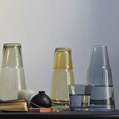 Night carafe A bedside glass of water will ensure guests don't have to stumble to the kitchen in the middle of the night. Opt for an elegant carafe-and-cup you can fill up before they arrive. Water Carafe, Water Bottles, Fathers Day Presents, Guest Bedrooms, Guest Room, Room Wall Decor, Beautiful Bedrooms, West Elm, Colored Glass