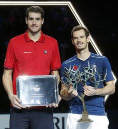 John Isner of the United States, left, and Britain's Andy Murray hold their trophy after the final of the Paris Masters tennis tournament at the Bercy Arena . Jamie Murray, Andy Murray, Tennis Tournaments, Single Player, Cheerleading, Masters, Champion, United States, Paris