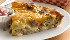 6 Servings Ingredients 1 lb lean (at least 80%) ground beef 1 large onion, chopped (1 cup) 1/2 teaspoon salt 1 cup shredded Cheddar cheese (4 oz) 1/2 cup Original Bisquick™ mix 1 cup milk 2 eggs Directions 1 Heat oven to 400°F. Spray 9-inch glass pie plate with cooking spray. 2 In 10-inch skil…