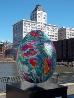 """The """"Big Egg Hunt"""" is on!  Over 260 eggs are on temporary display throughout New York City.  This was one of several at Brooklyn Bridge Park.  For me, the building in the background brings back childhood memories.  My grandfather worked there for over 50 years.  I am amazed by the total transformation of this area!"""