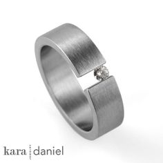 vintage diamond ring ~ tension-set in stainless steel by kara | daniel, via Flickr