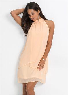 Sukienka koktajlowa marki Bodyflirt urzekająca swoim fasonem ze stójką zapinaną z tyłu na guziki i odsłoniętymi ramionami. Z miękko lejącego materiału, z zachodzącymi na siebie wstawkami z przodu.