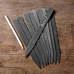 Blackboard Garden Markers, Set of 10 - Although these look nice and the wax crayon writing held up for the growing season, they rotted in the ground just like any popsicle stick. Herb Markers, Plant Markers, Garden Markers, Chalkboard Markers, Chalkboard Paint, Chalkboard Ideas, Chalk Paint, Slate Garden, Herb Garden
