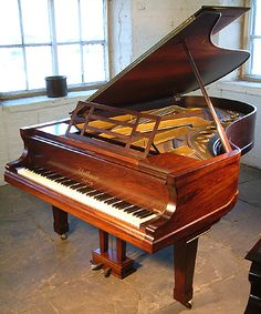 A 1912, Bluthner grand piano with a polished, rosewood case at Besbrode Pianos