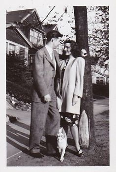 1940s found photo man woman on sidewalk dress jacket shoes hair suit pants shoes tie vintage fashion style print war era WWII