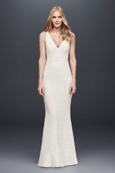 Entirely covered in tiny white sequins, this slim V-neck sheath gown needs no other embellishment to dazzle! DB Studio, exclusively at David's Bridal Polyester Back zipper; fully lined Dry clean Imported - Wedding Dress Bridal Party Dresses, Davids Bridal Dresses, Dream Wedding Dresses, Bridal Gowns, Wedding Gowns, Chiffon, Affordable Wedding Dresses, Lace Sheath Dress, Little White Dresses