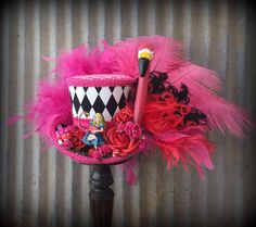 Alice in Wonderland Flamingo Mini Top Hat, Alice in Wonderland, Mad Hatter hat, Flamingo Diorama Mini top hat, Mad Hatter Hat, pink flamingo by ChikiBird on Etsy https://www.etsy.com/listing/515698009/alice-in-wonderland-flamingo-mini-top