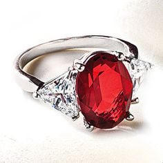 Carmen Lúcia Ruby Ring--The ring of this brilliant, sterling-silver-set parure replicates the spectacular 23.1 carat Burmese ruby ring, donated to the Smithsonian Institution by philanthropist Peter Buck in memory of his wife Carmen Lúcia. Our reproduction flanks a 14 x 10mm Austrian crystal with trillion cut cubic zirconia.