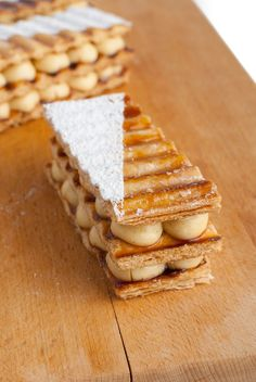 Millefeuille is a traditional French pastry. I believe the English speaking world knows it as a Napoleon. Traditionally, a millefeuille consists of three layers of puff pastry and in between those layers, two layers of pastry cream. There are many variatio