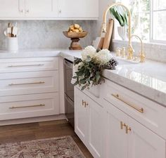 I want this marble throughout my entire kitchen along with the white cabinets and gold hardware. I also want this white sink with the gold faucets.