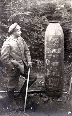 "A German NCO muses over the message chalked onto the casing of an unexploded 38cm shell: ""Ich habe den Krieg nicht gewollt"" - Chemin des Dames 1917."