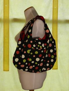 Polka Dots of happiness cover a purse fully lined in bright vivid pink.  2 external and 2 internal pockets. Snap closure.