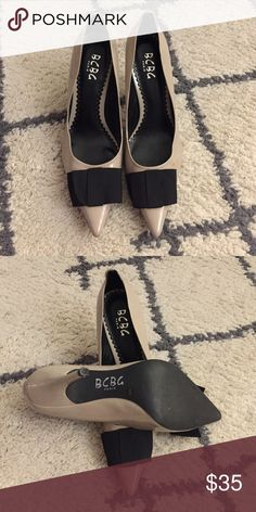 Like new BCBG bow pumps Nude patent leather BCBG pumps with adorable black grosgrain bow on the toes. Like new. BCBG Shoes Heels