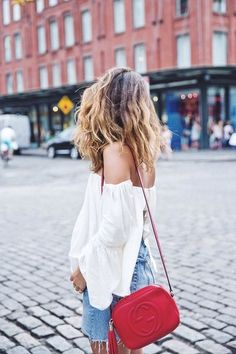A little red shoulder bag is the perfect accessory for any outfit.