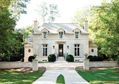 driveway, symmetry, double fireplaces, scale, shutters, oval windows (via Atlanta Homes)