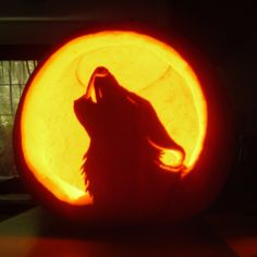 I altered a line drawing of a wolf to include a moon, printed it out, punched it into the pumpkin using a paring knife - and carved this, using only a steak knife and a paring knife. Hope you enjoy...