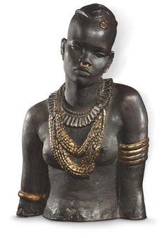 Adjugé 21000€ sans frais.  Anna Quinquaud (1890-1984),   Femme du Fouta Djallon, buste en grès rehaussé d'or   et d'argent, signé, Quimper, manufacture de la Hubaudière,   1930, 41 cm.