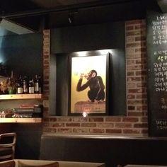 Monkey drinking vodka at Chez Flo.