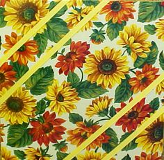 """Fabric Cork Bulletin Boards. Sunflowers with yellow diagonal message ribbons, 12"""" x 12, $24.20, OR,  Your choice of over 1000 fabrics; four standard sizes and custom; with or without message ribbons; and lots more at www.PushPinsAndFabricCorkBoards.com ; subcategory YELLOW.   Also matching DECORATIVE PUSH PINS. #fabriccorkbulletinboards #decorativepushpins #fabricwallart  #interior designers  #YELLOW"""