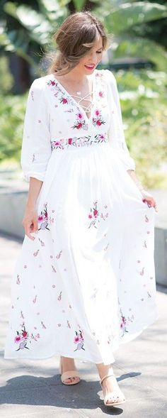 White maxi dress with floral patterns