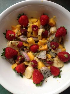 Today's bowl was banana, mangoes, dragon fruit, raspberries and strawberries, topped with passion fruit seeds :)