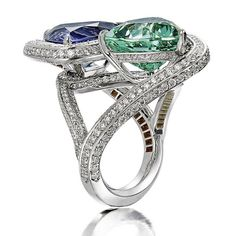 Another view of our new favorite ring featuring trillion cut #tanzanite and mint #tourmaline gemstones suspended in 18kt white gold with #diamonds.