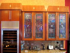 These custom stained glass contemporary cabinets feature a piece of leaded glass with a glass rondel in each window. Let us design glass inserts for you! Custom Stained Glass, Faux Stained Glass, Stained Glass Designs, Stained Glass Panels, Leaded Glass, Stained Glass Cabinets, Glass Kitchen Cabinets, Glass Cabinet Doors, Kitchen Reno