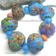 ANASTASIA--handmade lampwork beads--(7)-- EARLY FLOWERS --SRA