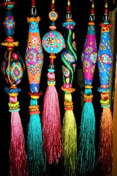 Brightly colored tassels with handpainted wooden tops / beads
