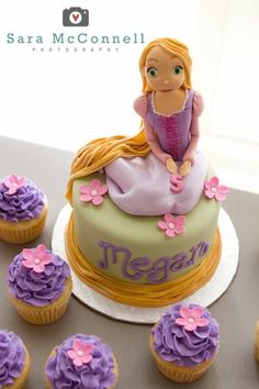 Tangled Birthday Cake- I love the cupcakes with the pink flowers