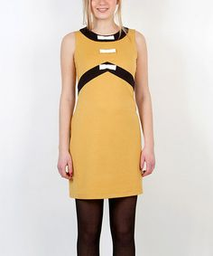 Take a look at this Yellow & Black Ribbon Empire-Waist Dress by Titis Clothing--Bows are silly but I like the colorblocking